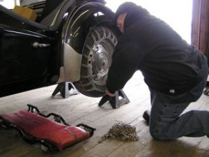 John attaches tire chains for a roadtest