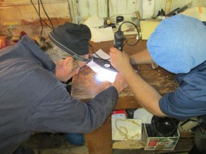 Close Work:  Steve helps Butch with a horn ring for another Jaguar