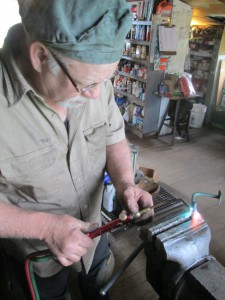Butch repairs Healey throttle linkage